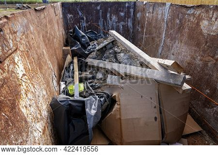 Inside A Dumpster On A Home Building Site Where Rubbish Is Discarded