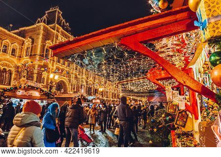 Moscow, Russia - January 1, 2018: Illuminated Christmas Market In The Winter Season. People Shopping