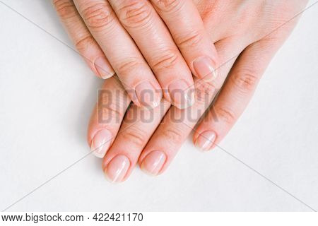 Woman In A Nail Salon Receiving A Manicure By A Beautician With Nail File. Beauty And Hand Care Clos
