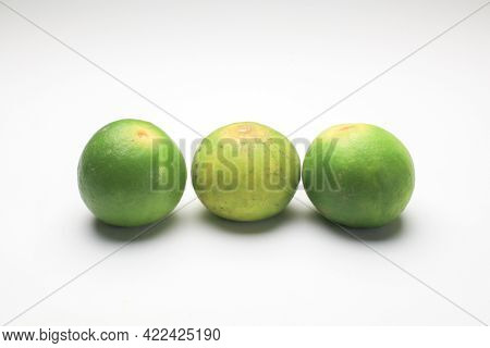 Fresh Lime Isolated On White Background. Texture Pattern Juicy Green Tropical Lime Fruit. Image Gree