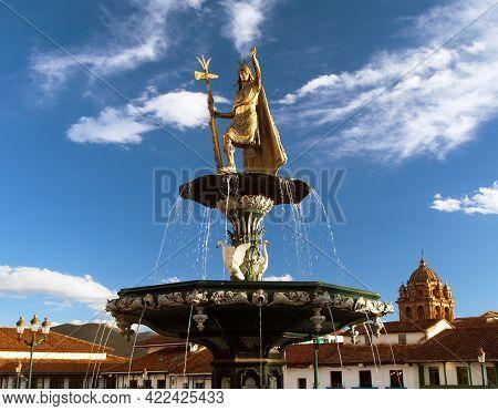 Statue Of Inca Pachacutec On Fountain And Catholic Church On Plaza De Armas, Cusco Or Cuzco Town, Pe