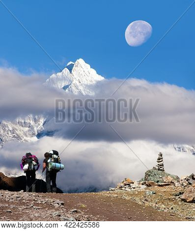 View Of Mount Thamserku In The Middle Of Clouds, Moon And Two Tourists, Khumbu Valley, Solukhumbu, N