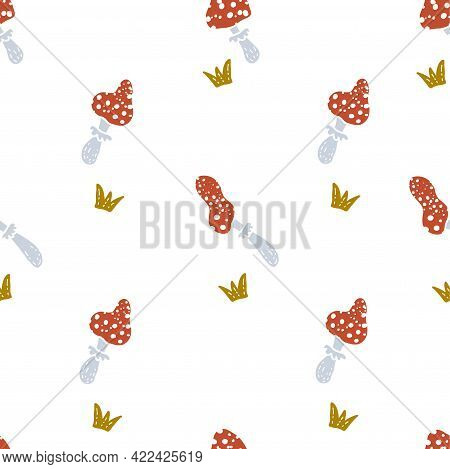 Cartoon Style Doodle Seamless Pattern Of Red Mushrooms Toadstools And Grass. Hand Drawn Vector Illus
