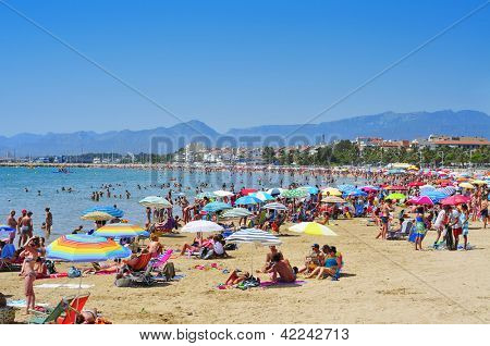CAMBRILS, SPAIN - AUGUST 10: Vacationers in Prat de en Fores Beach on August 10, 2012 in Cambrils, Spain. This destination for sun and beach for European tourism offers more than 22,000 accommodations