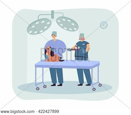 Vets Examining Dog And Giving Medicine. Domestic Animal On Table, Assistant Holding Tray With Bottle