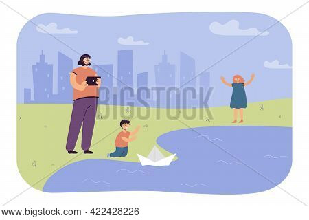 Little Boy Launching Paper Boat On Lake. Sister Filming Child On Tablet, Happy Girl Cheering For Bro