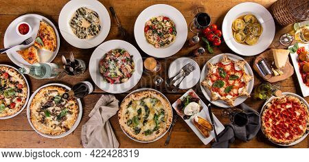 Big Dinner Table With Italian Food, Pizzas And Pastas