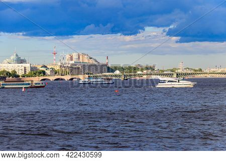 White Yacht And Tourist Boats Sailing On The Neva River In St. Petersburg, Russia