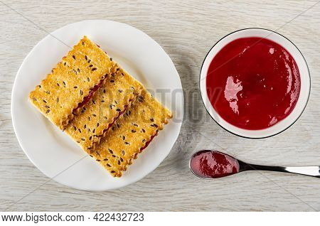 Sandwiches From Crackers With Flax Seeds And Cherry Jam In White Plate, Bowl With Jam, Teaspoon With