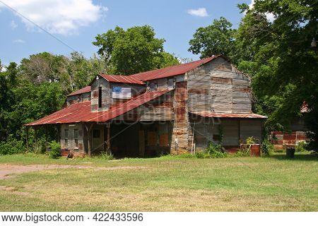 Rustic Rural Barn With American Flag In Rural Texas