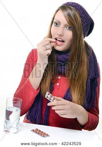 Cute Girl Taking Drug Against A White Background
