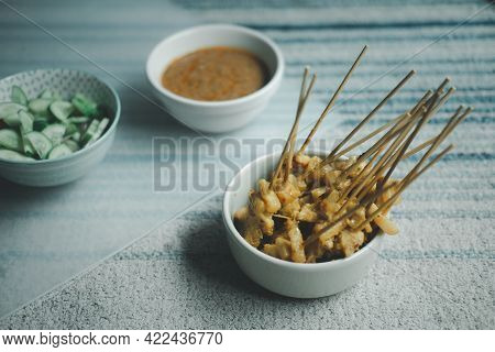 Grilled Pork Satay Served With Peanut Sauce Or Sweet And Sour Sauce. Thai Food