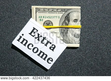 Dollars Cash Money And Paper Note With Text Written Extra Income. Concept Of Financial Planning. Mak