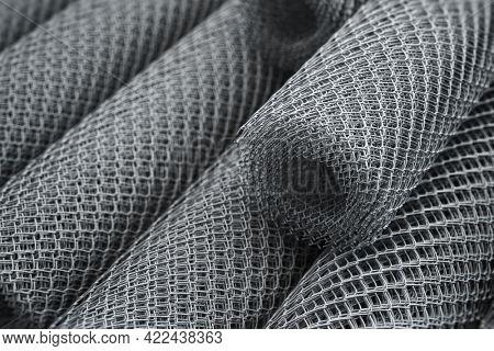 Coils of steel wire. Rabitz mesh netting rolls in warehouse. 3d illustration