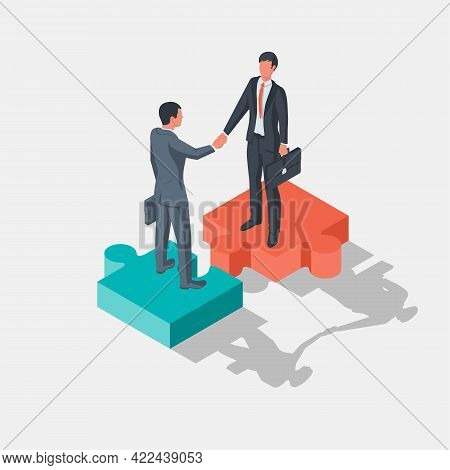 Two Businessmen Stand On Pieces Of Puzzle As Symbol Of Connection. Combining Two Alliances. Partners