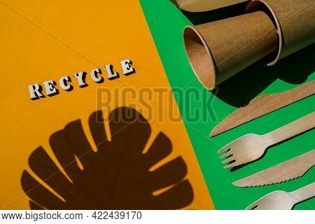 Recycle Text Wooden Forks And Paper Cups With Plates On Color Background. Eco Friendly Disposable Ta
