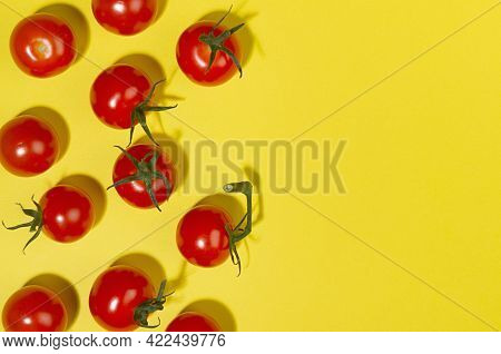 Juicy Red Tomato With Green Tail And Shadow On Yellow Background, Border, Copy Space, Top View. Mode