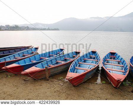 Wooden Canoe Boat Of Nepali People Floating In Phewa Tal Or Fewa Freshwater Lake Wait Service Nepale
