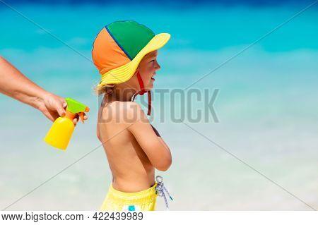 Mom Applying Sunscreen On Child. Safe Beach And Sun Tan Fun. Uv Protection For Young Kid. Skin Healt