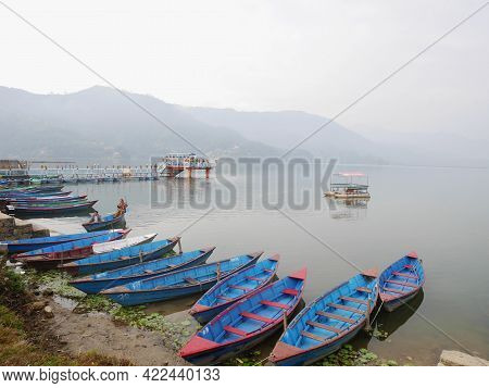 Wooden Canoe Boat Floating In Phewa Tal Or Fewa Freshwater Lake Wait Service Nepali People And Forei