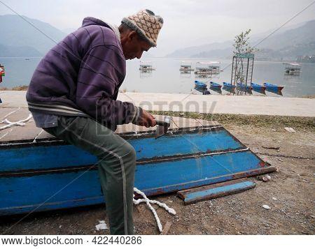 Nepali Old Man Carpenter Or Repairman Senior Nepalese People Working Repair Wooden Boat Beside Of Ph