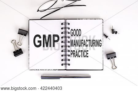 Notebook With Gmp Good Manufacturing Practice On Table