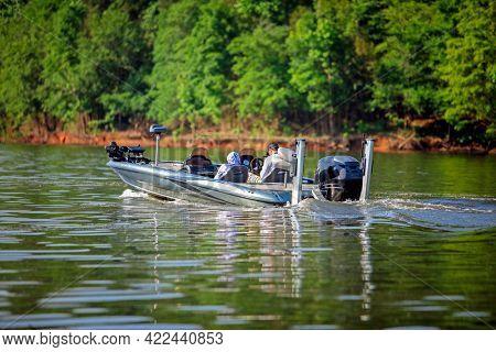 Speedboat cruising on a calm lake