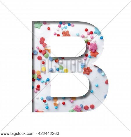 Sweet Glaze Font. The Letter B Cut Out Of Paper On The Background Of White Sweet Glaze With Colored