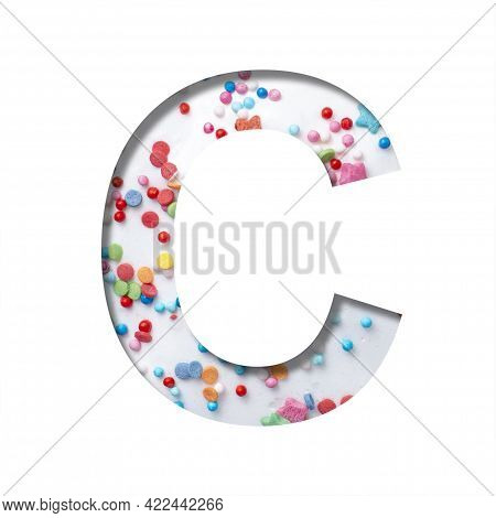 Sweet Glaze Font. The Letter C Cut Out Of Paper On The Background Of White Sweet Glaze With Colored