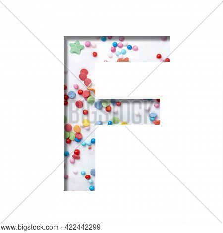 Sweet Glaze Font. The Letter F Cut Out Of Paper On The Background Of White Sweet Glaze With Colored