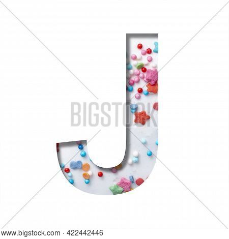 Sweet Glaze Font. The Letter J Cut Out Of Paper On The Background Of White Sweet Glaze With Colored