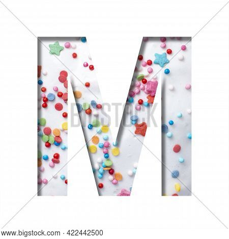 Sweet Glaze Font. The Letter M Cut Out Of Paper On The Background Of White Sweet Glaze With Colored