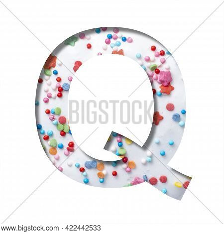 Sweet Glaze Font. The Letter Q Cut Out Of Paper On The Background Of White Sweet Glaze With Colored