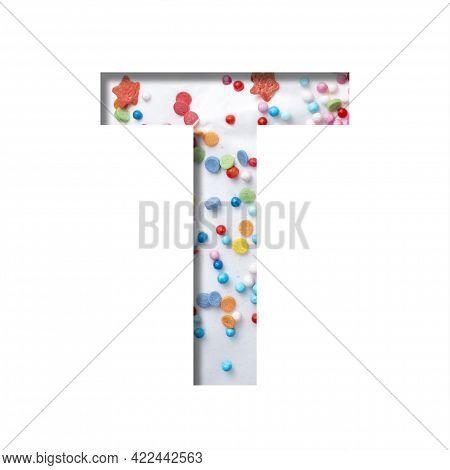 Sweet Glaze Font. The Letter T Cut Out Of Paper On The Background Of White Sweet Glaze With Colored