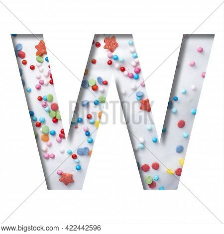 Sweet Glaze Font. The Letter W Cut Out Of Paper On The Background Of White Sweet Glaze With Colored