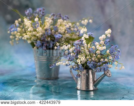 Still life with a beautiful bouquet of white flowers - lilies of the valley. Spring time background with copy space, nature concept