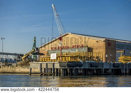 Melbourne, Australia - May 17, 2019: View Of The Victoria Dock Company Along The Yarra River. The Co