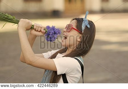 Birthday Party. Happy Girl Have Fun With Flowers. Party Look Of Small Child. Holiday Party. Enjoying