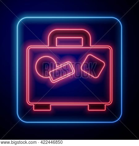 Glowing Neon Suitcase For Travel Icon Isolated On Black Background. Traveling Baggage Sign. Travel L