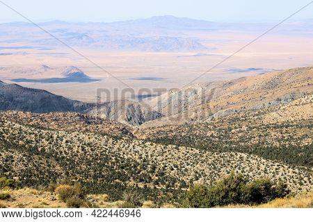 Arid Mountain Ridges And Canyons Overlooking The Arid Mojave Desert Taken On An Alpine Plateau At Th