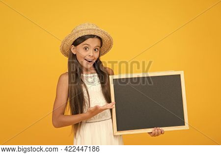 You Need This Product For School. Happy Girl Presenting Product. Little Child Hold School Blackboard