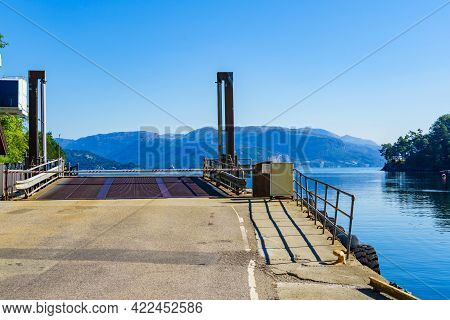 Ferry Boat Approaching Ramp Entrance, Fjord In Norway