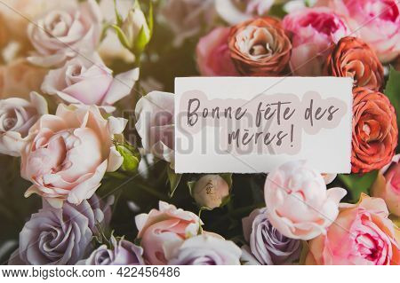 White Gift Card With The Inscription Happy Mothers Day In French In A Bouquet Of Bright Beautiful Mu