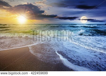 Day And Night Time Change Concept Above Sea Tide On A Cloudy Twilight. Green Waves Crashing Golden S