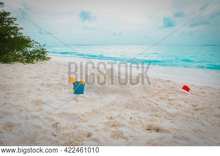 Kids Toys And Sandcastle On Tropical Beach
