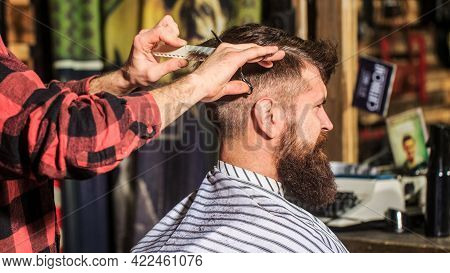 Bearded Man In Barber Shop. Work In The Barber Shop. Man Hairstylist. Hairdresser Cutting Hair Of Ma