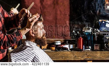 Hairstylist Serving Client At Barber Shop. Man Visiting Hairstylist In Barbershop. Bearded Man In Ba