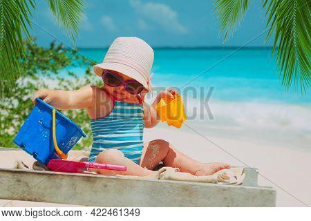 Cute Happy Girl Play With Sand On Beach