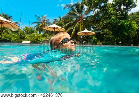 Kid Swimming At Tropical Beach Resort, Family Vacation