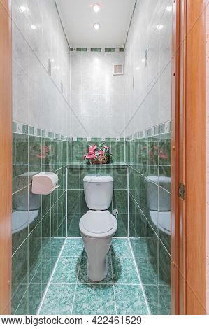Photo Of A Small Toilet Room With A Toilet Bowl, Vertical Format